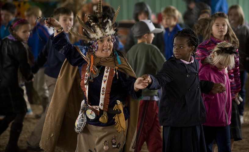 Elizabeth Dreamerwings Ortiz, of Edinburg, leads a group of students in the snake dance during The Gathering, a Native American festival at the Clarke County Fairgrounds, on Friday morning in Berryville. The festival continues this weekend.  Rich Cooley/Daily